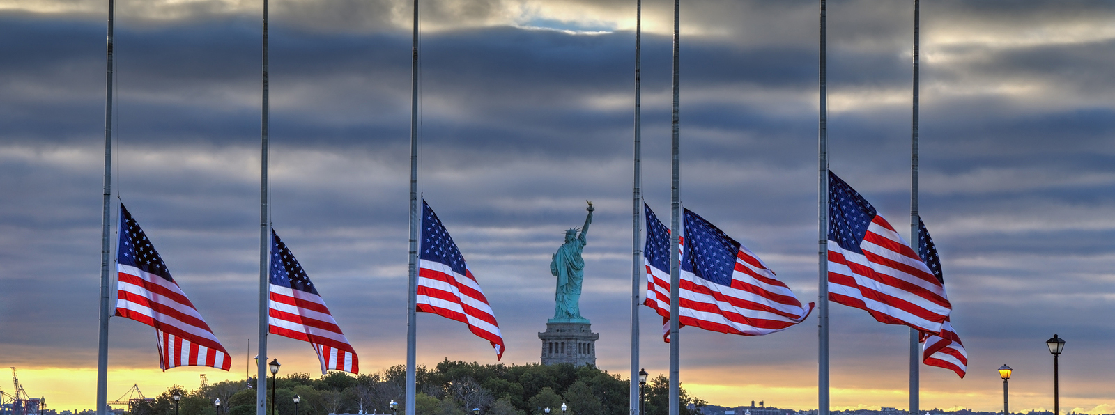 bigstock-Flags-at-half-staff-in-front-o-74578162